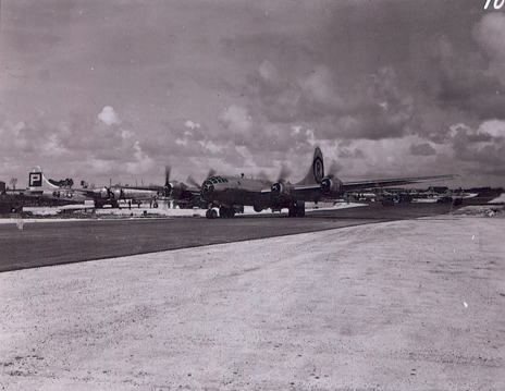 The Enola Gay returns to Tinian Island after the strike on Hiroshima.
