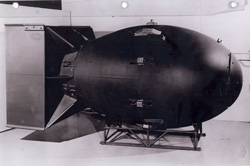 A nuclear weapon of the Fat Man type, the plutonium implosion type detonated over Nagasaki. 60 inches in diameter and 128 inches long, the weapon weighed about 10,000 pounds and had a yield approximating 21,000 tons of high explosives (Copy from U.S. National Archives, RG 77-AEC)